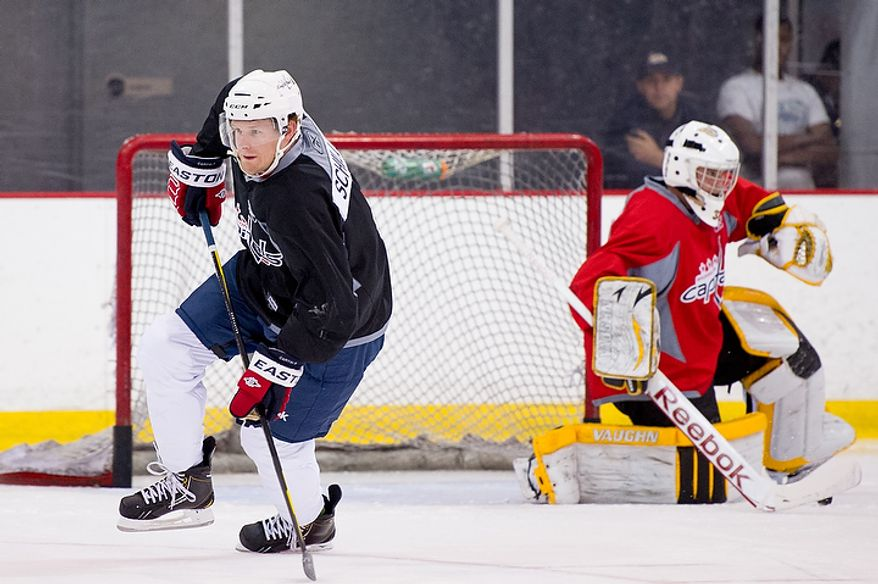 Cameron Schilling (left) practices with the Washington Capitals on their first day of development camp at the Kettler Capitals Iceplex in Arlington on Monday, July 9, 2012. (Andrew Harnik/The Washington Times)
