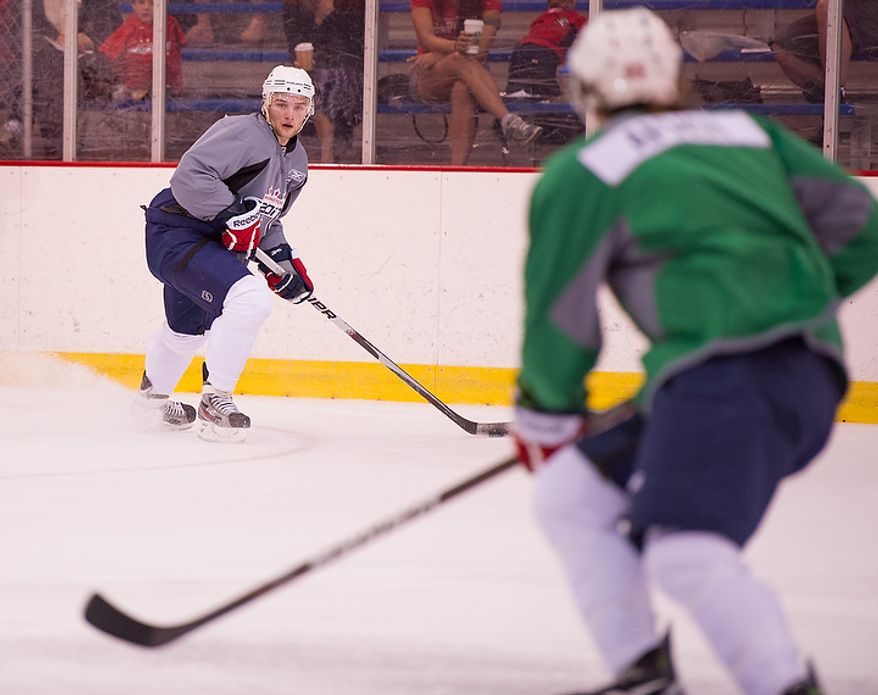 Nathan Walker (left) practices with the Washington Capitals on their first day of development camp at the Kettler Capitals Iceplex in Arlington on Monday, July 9, 2012. (Andrew Harnik/The Washington Times)