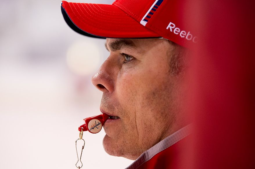 Washington Capitals head coach Adam Oates watches the first day of practice at the annual development camp at the Kettler Capitals Iceplex in Arlington on Monday, July 9, 2012. (Andrew Harnik/The Washington Times)