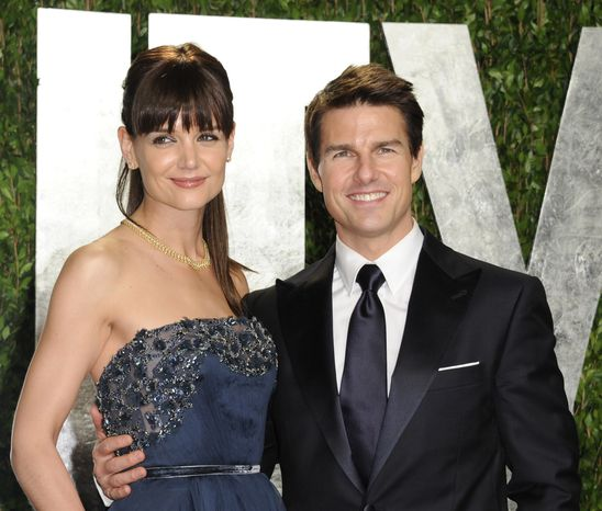 ** FILE ** Tom Cruise and Katie Holmes arrive on Feb. 26, 2012, at the Vanity Fair Oscar party in West Hollywood, Calif. (Associated Press)