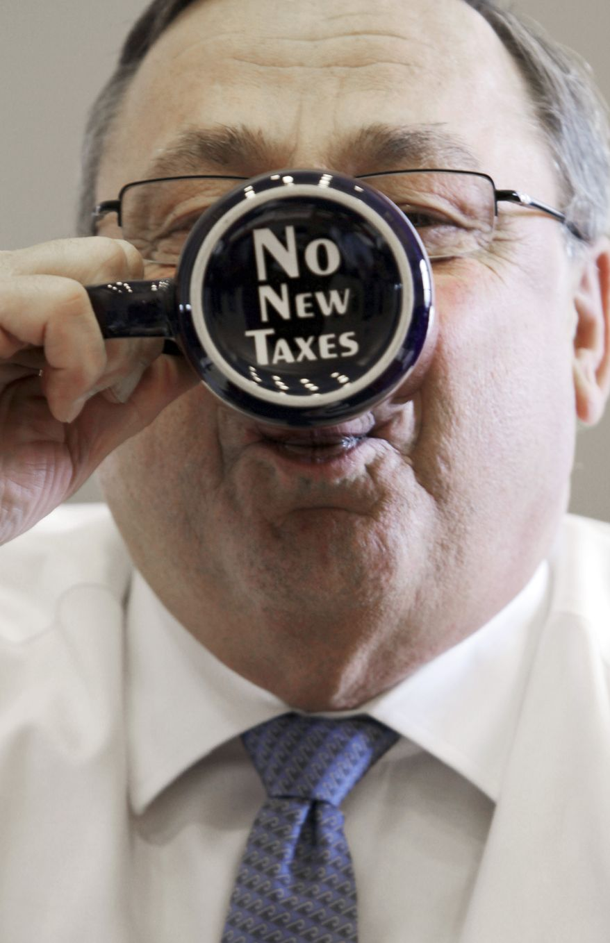 "** FILE ** Maine Gov. Paul LePage takes a sip from a coffee mug displaying a ""no new taxes"" message, April 27, 2012. (AP Photo/Pat Wellenbach)"