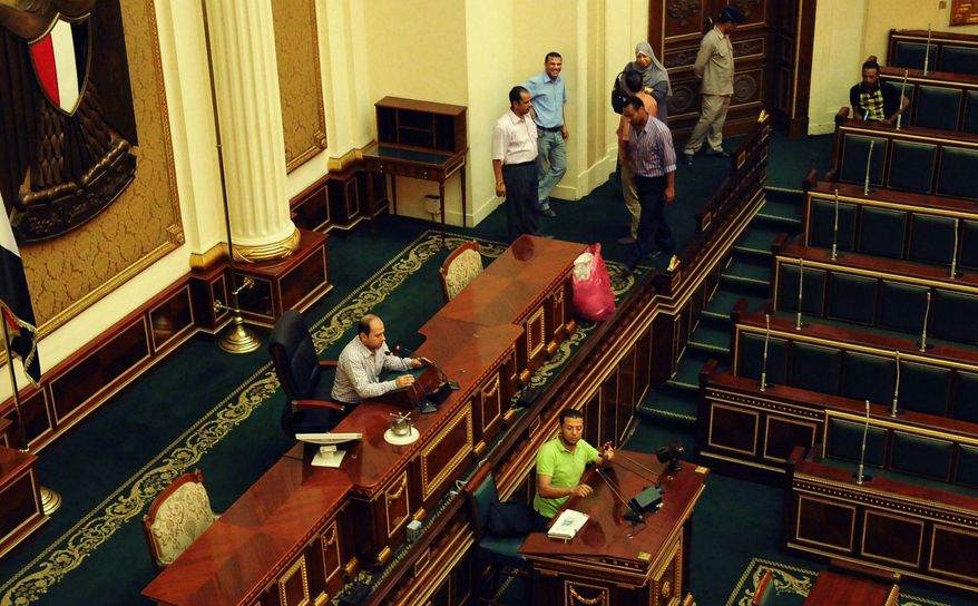 Officials are seen July 9, 2012, in the Egyptian parliament in Cairo. (Associated Press)