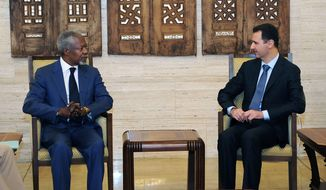 International envoy Kofi Annan (left) meets July 9, 2012, with Syrian President Bashar Assad in Damascus, Syria. (Associated Press/SANA)