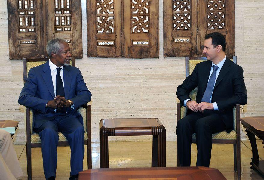 International envoy Kofi Annan (left) meets July 9, 2012, with Syrian President Bashar Assad in Damascus, Syria. (Associated Press/SANA)