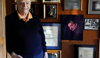 Ernest Borgnine relaxes at his home in Beverly Hills, Calif., in October 2010. Mr. Borgnine died of kidney failure on Sunday at the age of 95. (Associated Press)