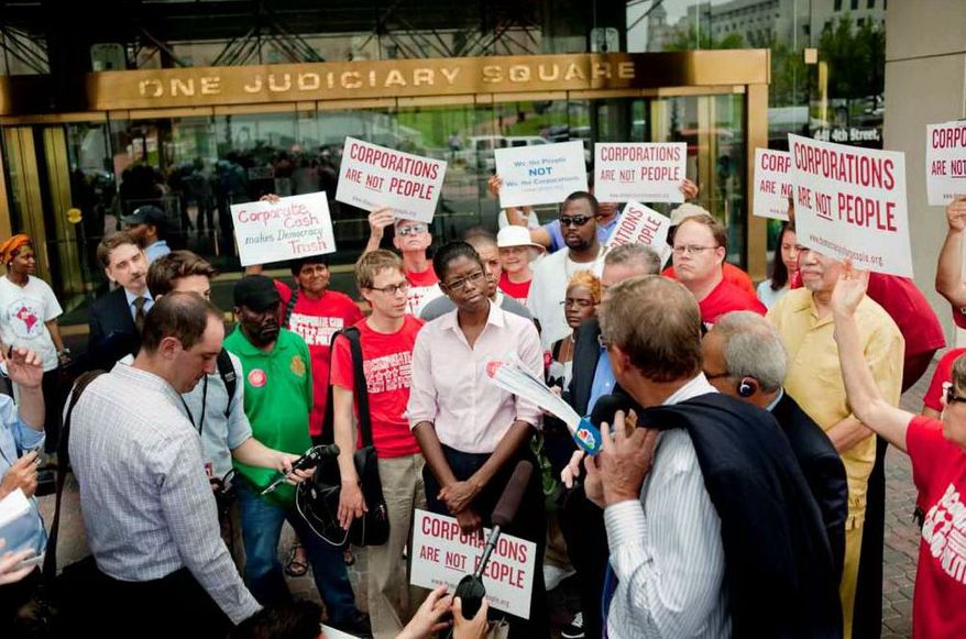 Initiative 70 delivered 30,000 signatures to ban corporate contributions to local politicians during a press conference held at Judiciary Square on Monday, July 9, 2012, in the District (Raymond Thompson/The Washington Times)