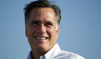 **FILE** Republican presidential candidate Mitt Romney campaigns June 19, 2012, in Holland, Mich. (Associated Press)