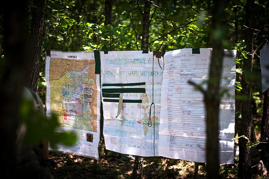 Maps are posted up on a line between trees for the planning of a mission during another day of Sapper School training at U.S. Army Maneuver Support Center (MANSCEN) and Fort Leonard Wood in Fort Leonard Wood, Mo., Monday, June 25, 2012. (Rod Lamkey Jr./The Washington Times)