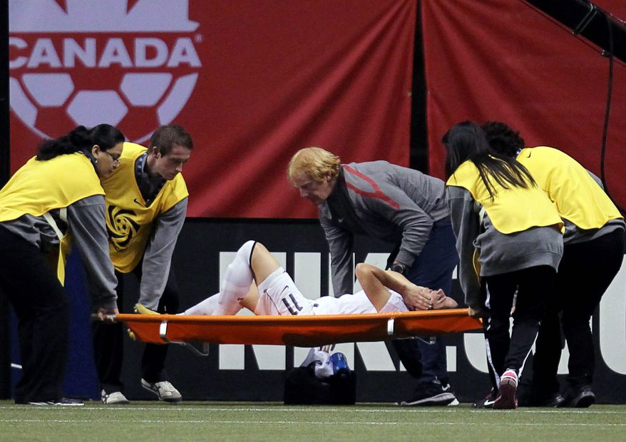 Ali Krieger, a Dumfries native, suffered a torn ACL and MCL during the United States' 14-0 win over the Dominican Republic in an Olympic qualifying match in January. The 27-year old also plays for the German club FFC Frankfurt. (Associated Press)