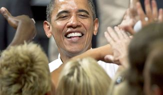 President Obama greets supporters after a campaign event at a community college in Cedar Rapids, Iowa, on Tuesday, July 10, 2012. (Associated Press)