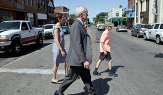 "Bob Kerrey, a Democratic candidate for a Senate seat in Nebraska, tours the Benson neighborhood in Omaha with his wife, former Saturday Night Live writer Sarah Paley, and Henry, his son. Mr. Kerrey has described Ms. Paley as a ""comedian."" (Associated Press)"