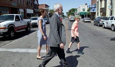 """Bob Kerrey, a Democratic candidate for a Senate seat in Nebraska, tours the Benson neighborhood in Omaha with his wife, former Saturday Night Live writer Sarah Paley, and Henry, his son. Mr. Kerrey has described Ms. Paley as a """"comedian."""" (Associated Press)"""