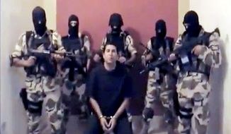 **FILE** Suspected members of Mexico's Sinaloa drug cartel hold Mario Gonzalez hostage before murdering him in October 2010.