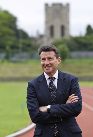 Sebastian Coe, chairman of the London 2012 Organizing Committee, poses for pictures on the running track at Iffley Road Stadium in Oxford, England, Tuesday July 10, 2012. Sir Roger Bannister who was the first person ever to run a sub four-minute-mile, on May 6, 1954, at this track, returned to the site of his greatest sporting achievement, to participate in the Olympic Torch relay as the Olympic flame is carried around the country to the opening ceremony of the 2012 London Olympic Games. (AP Photo/Lefteris Pitarakis)