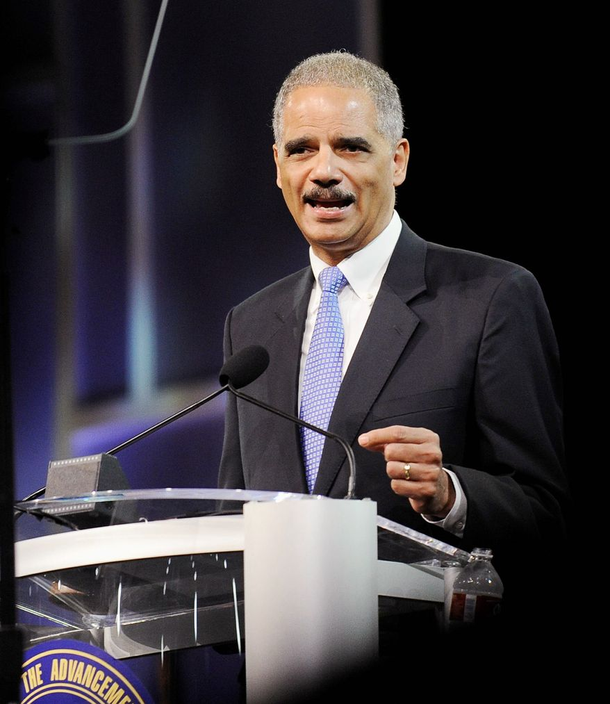 Attorney General Eric H. Holder Jr. speaks at the NAACP convention in Houston on Tuesday. Mr. Holder says a new photo-ID requirement in Texas elections would be harmful to minority voters. (Associated Press)