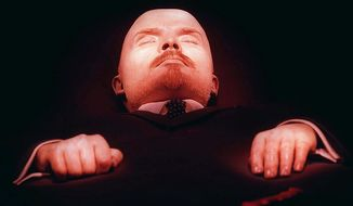 Vladimir Lenin, founder of the Soviet Union, lies embalmed in his tomb on Moscow's Red Square on Wednesday, April 16, 1997, six days before his 127th birthday on April 22. (AP Photo/Sergei Karpukhin)