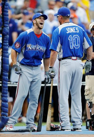Generations crossed when Bryce  Harper and Chipper Jones shared a light moment before the All-Star Game. (Associated Press)