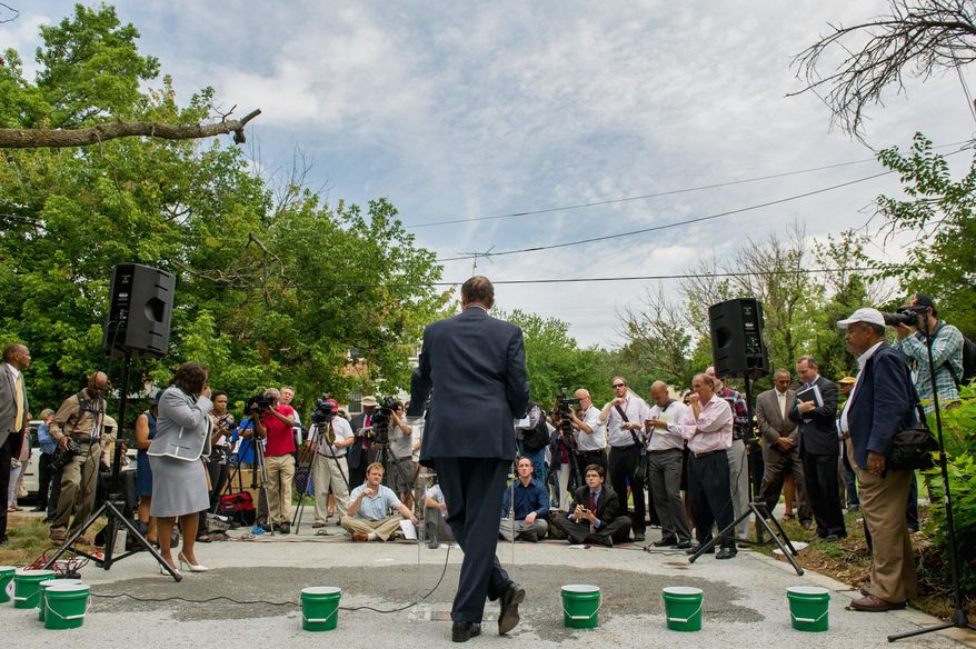 "D.C. Mayor Vincent C. Gray (above) answers reporters' questions Wednesday, one day after political operative Jeanne C. Harris, 75, pleaded guilty to funneling undocumented campaign funds to the 2010 Gray campaign for mayor. Mr. Gray (left) spoke about the probe after holding a press conference to discuss a green alley program in Northeast. ""I never expected to see so many people in an alley in Ward 7,"" he said. (Andrew Harnik/The Washington Times)"