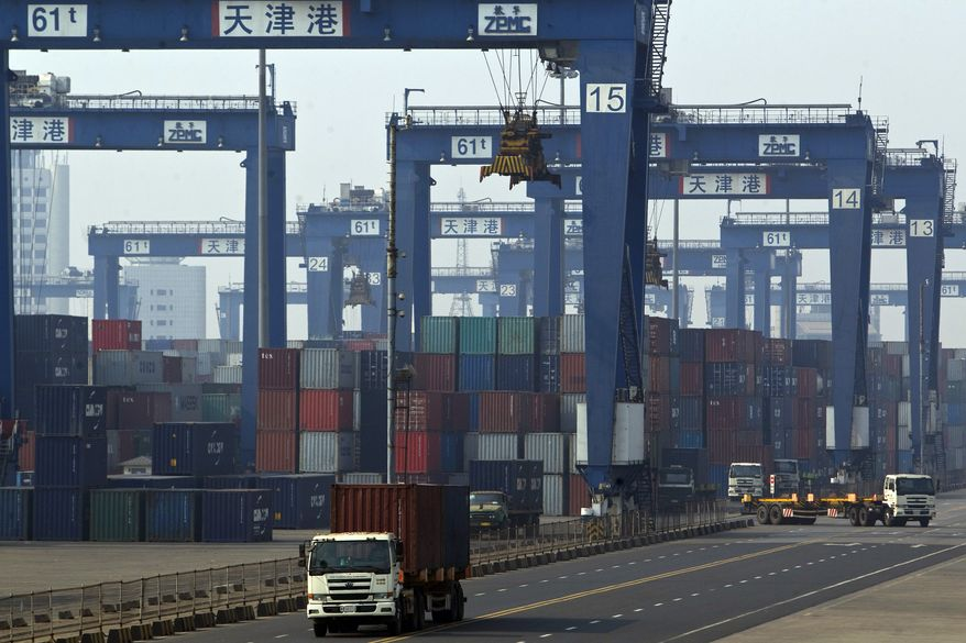 Trucks transport shipping containers at the port of Tianjin, China, in February 2012. (AP Photo/Alexander F. Yuan)