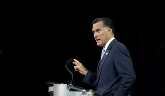 Republican presidential candidate Mitt Romney speaks to the annual convention of the National Association for the Advancement of Colored People on Wednesday, July 11, 2012, in Houston. (AP Photo/Evan Vucci)