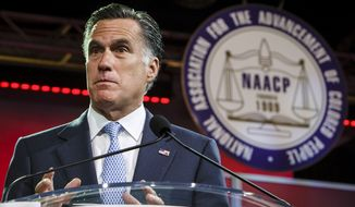 Republican presidential candidate Mitt Romney pauses July 11, 2012, during a speech to the NAACP annual convention in Houston. (Associated Press/Houston Chronicle)