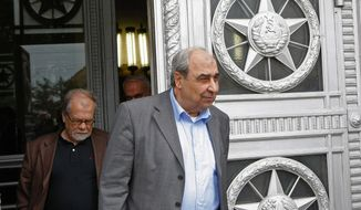 Syrian opposition leader Michel Kilo (right) and other members of his delegation leave Russia's Foreign Ministry after a meeting with Foreign Minister Sergey Lavrov in Moscow on Monday, July 9, 2012. (AP Photo/Alexander Zemlianichenko)