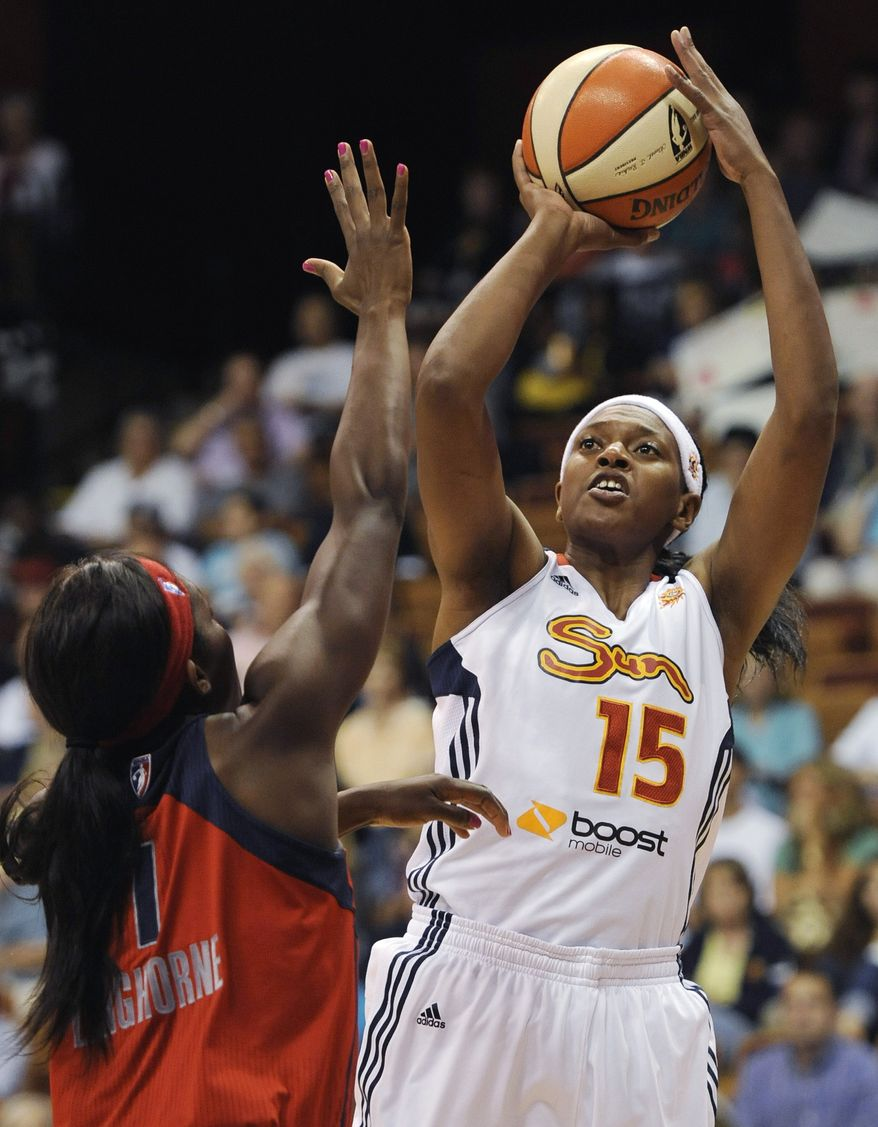 Connecticut Sun's Asjha Jones (15) shoots over Washington Mystics' Crystal Langhorne during the first half of a WNBA basketball game in Uncasville, Conn., Wednesday, July 11, 2012. (AP Photo/Jessica Hill)