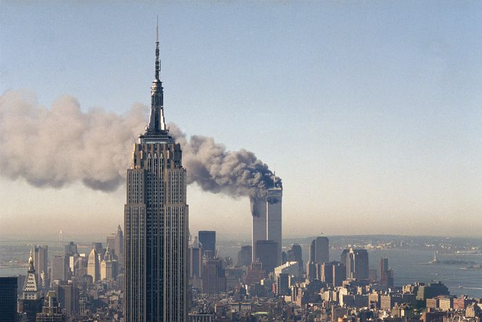 """*"""" FILE ** The twin towers of the World Trade Center burn on Sept. 11, 2001, behind the Empire State Building in New York. (Associated Press)"""