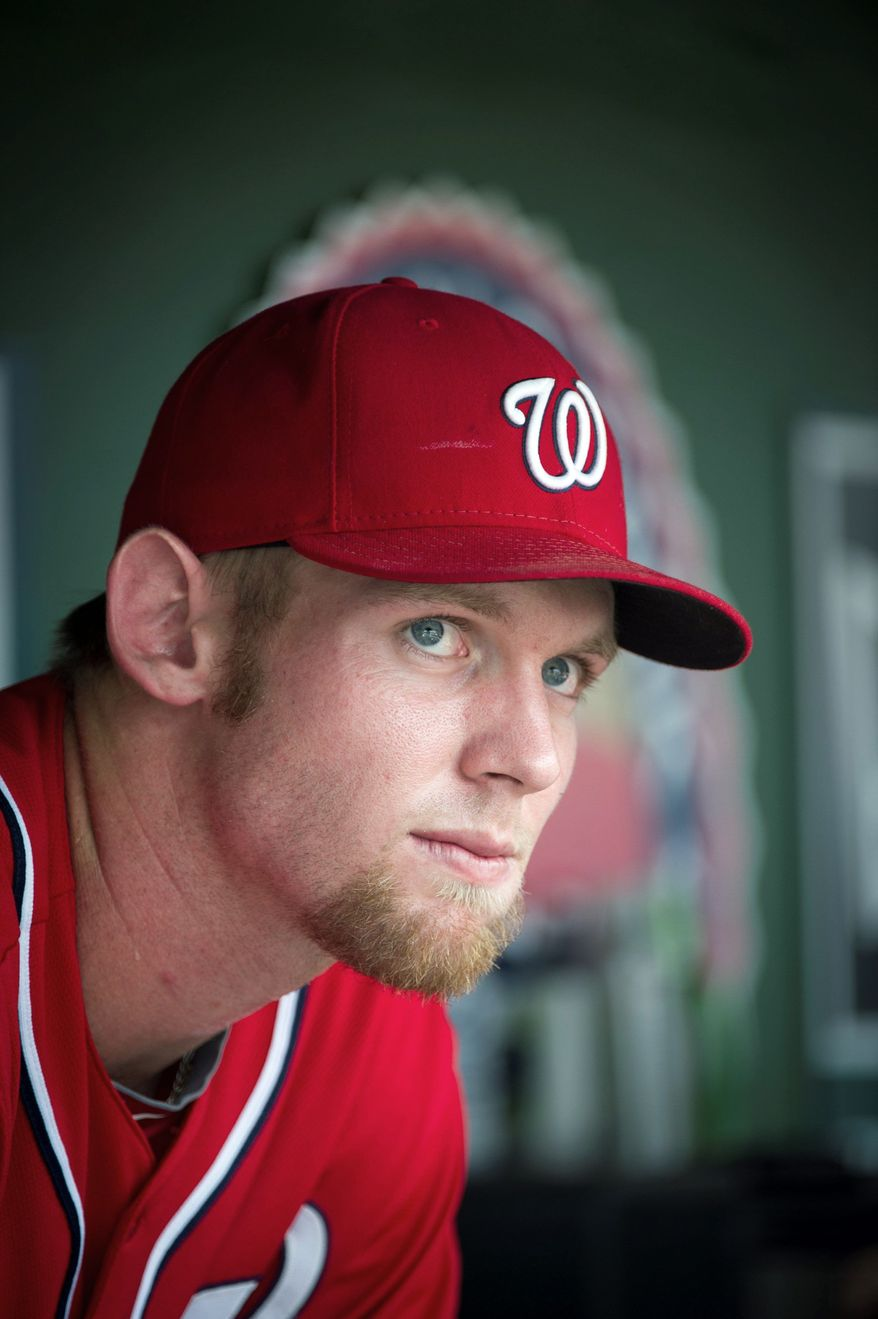 Nationals Stephen Strasburg sits in the shade of the dugout as the Washington Nationals host the Colorado Rockies at Nationals Park in Washington, D.C., Sunday, July 8, 2012. (Rod Lamkey Jr./The Washington Times)