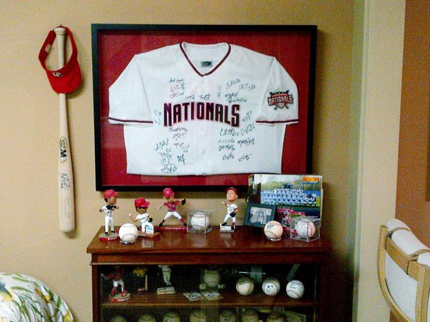 Memorabilia display in the basement of Steve and Phyllis Wilson's home in Woodbridge, Va. The Wilsons have served as a host family for minor leaguers with the Nationals' Potomac affiliate, including several who have made it to the major leagues. (Amanda Comak/The Washington Times)