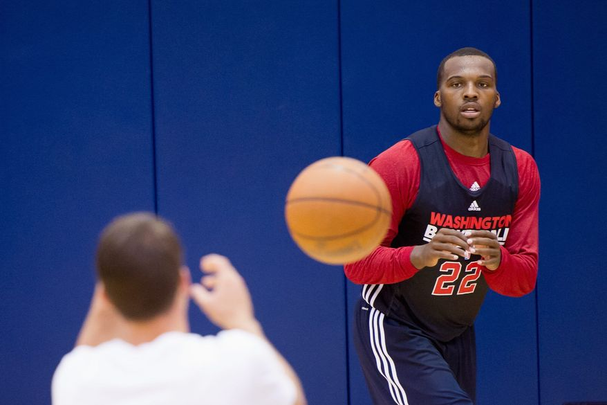 Shelvin Mack, taken 34th overall by the Wizards in 2011, averaged 3.6 points and 2.0 assists in his lockout-shortened rookie season. (Andrew Harnik/The Washington Times)