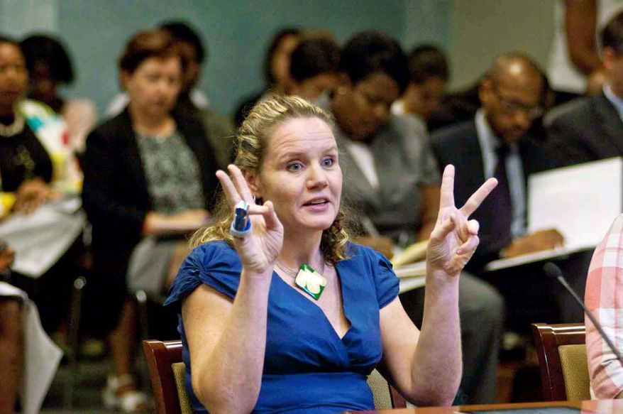Witness Carrie Pecover, from Seeds of Tomorrow, Inc., answers questions during Chairman Phil Mendelson Committee of the Whole and the Committee on the Judiciary roundtable on Truancy Reduction in the D.C. Public Oversight Roundtable on Thrusday, July 12, 2012, in Washington D.C.. (Raymond Thompson/The Washington Times)