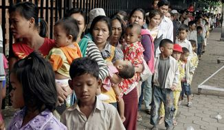 Cambodian villagers wait for checkups outside a children's hospital in Phnom Penh Wednesday. A virulent form of hand, foot and mouth disease has killed hundreds of young children in Asia, where the illness is commong and usually not severe. (Associated Press)