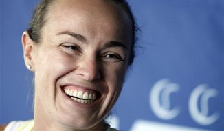 Switzerland's Martina Hingis, of New York Sportimes, smiles during a news conference before a World TeamTennis match against the Washington Kastles, Wednesday, July 20, 2011, in New York. (AP Photo/Daniel P. Derella)