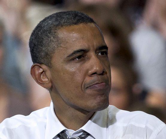 President Obama pauses while speaking at Kirkwood Community College in Cedar Rapids, Iowa, on Tuesday, July 10, 2012. (AP Photo/Nati Harnik)