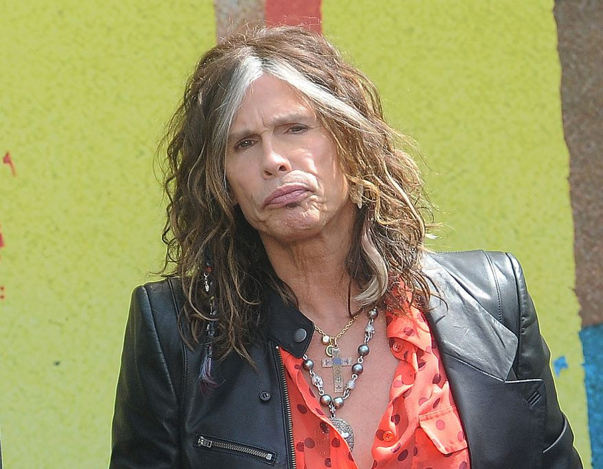 """** FILE ** This March 28, 2012, file photo shows Steven Tyler speaking at the Aerosmith news conference announcing the 2012 Global Warming Tour in Los Angeles. Tyler announced Thursday, July 12, 2012, that he will not be returning as a judge on the singing competition series """"American Idol."""" (AP Photo/Katy Winn, file)"""
