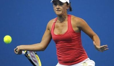 Russia's Arina Rodionova returns a ball to Anne Keothavong of Britain during their first round match at the Australian Open tennis championships in Melbourne, Australia, Monday, Jan. 17, 2011.   (AP Photo/Vincent Thian)
