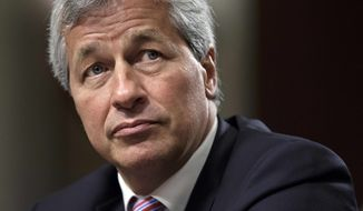 **FILE** JPMorgan Chase CEO Jamie Dimon, head of the largest bank in the United States, testifies on June 13, 2012, before the Senate Banking Committee on Capitol Hill in Washington. (Associated Press)