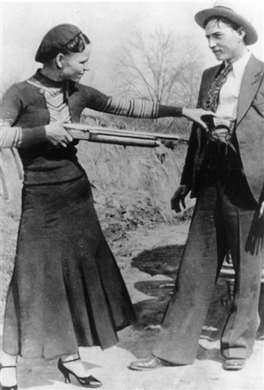 FILE - This this undated file photo shows outlaws and lovers Bonnie Parker, left, and Clyde Barrow. Guns and other items connected to the couple are going on auction by RR Auction of Amherst, N.H. An auction official estimated Thursday, July 12, 2012, that the handguns found on the duo after they were shot dead each could fetch between $100,000 and $200,000. (AP Photo/File)