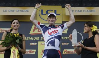 Stage winner Andre Greipel of Germany celebrates on the podium of the 13th stage of the Tour de France cycling race over 217 kilometers (134.8 miles) with start in Saint-Paul-Trois-Chateaux and finish in Le Cap D'Agde, France, Saturday July 14, 2012. (AP Photo/Laurent Cipriani)