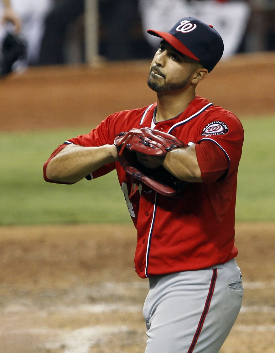 Washington Nationals' Gio Gonzalez heads the the dugout after Miami Marlins' John Buck drove in a run in the fifth inning in Miami on Saturday, July 14, 2012. The Marlins won 2-1. (AP Photo/Alan Diaz)