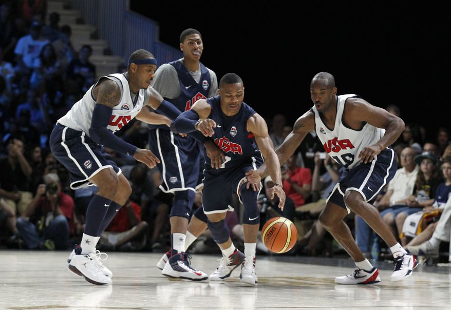 USA Basketball forward Carmelo Anthony, left, and guard Kobe Bryant, right, work against guard Russell Westbrook (7) with forward Anthony Davis (14) behind, during practice Saturday, July 14, 2012 in Washington. (AP Photo/Alex Brandon)