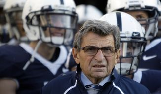"""FILE - In this Nov. 7, 2009, file photo, Penn State Coach Joe Paterno stands with his players before taking the field for an NCAA college football game against Ohio State in State College, Pa. Paterno and other senior Penn State officials """"concealed critical facts"""" about Jerry Sandusky's child abuse because they were worried about bad publicity, according to an internal investigation into the scandal released Thursday, July 12, 2012. (AP Photo/Carolyn Kaster, File)"""