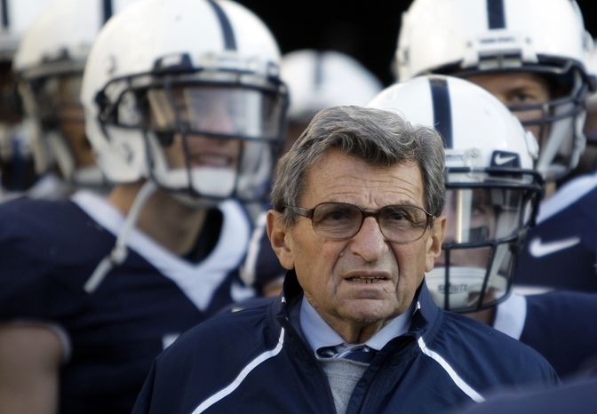 "FILE - In this Nov. 7, 2009, file photo, Penn State Coach Joe Paterno stands with his players before taking the field for an NCAA college football game against Ohio State in State College, Pa. Paterno and other senior Penn State officials ""concealed critical facts"" about Jerry Sandusky's child abuse because they were worried about bad publicity, according to an internal investigation into the scandal released Thursday, July 12, 2012. (AP Photo/Carolyn Kaster, File)"