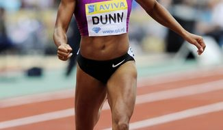 FILE - In this Aug. 14, 2010, file photo, Debbie Dunn, of the United States, competes in the women's 400 meters during a Diamond League Athletics meeting at Crystal Palace in London. Dunn took her name off the U.S. Olympic team roster Friday, July 13, 2012, after testing positive for excessive testosterone. Dunn, who finished fourth in the 400 meters at Olympic trials, was selected for the American relay pool. She is the 2010 world indoor champion at 400 meters and would have been a likely candidate to run in the Olympic 1,600-meter relay, which the American women have won every year since 1996. (AP Photo/Tom Hevezi, File)