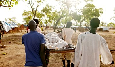 Men carry an extremely sick girl to the only medical center in the Yida refugee camp in Unity State, South Sudan on Saturday, May 12, 2012. With more than 30,000 residents, many of whom are undernourished, the few international aid organizations operating in Yida struggle to provide sufficient services. (Associated Press)