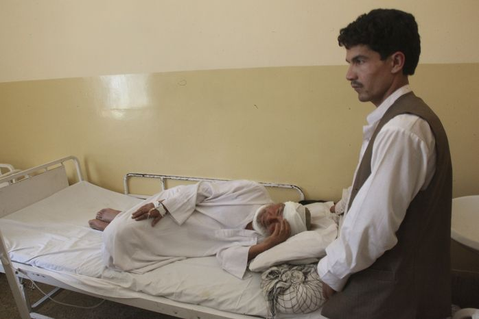 An Afghan who was wounded in a suicide attack during wedding festivities lies in a hospital in Samangan province north of Kabul, Afghanistan, on Saturday, July 14, 2012. (AP Photo/Jawed Dehsabzi)