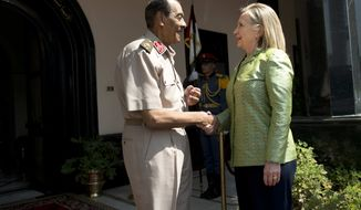 Egyptian Field Marshal Hussein Tantawi greets U.S. Secretary of State Hillary Rodham Clinton before a meeting at the Ministry of Defense in Cairo on Sunday, July 15, 2012. (AP Photo/Brendan Smialowski, Pool)