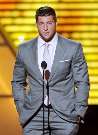 Tim Tebow speaks onstage at the ESPY Awards on Wednesday, July 11, 2012, in Los Angeles. (Photo by John Shearer/Invision/AP)