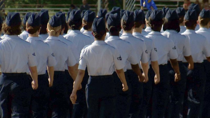Female graduates of the Air Force's basic-training program march during ceremonies at Lackland Air Force Base in San Antonio on Friday, June 22, 2012, in an image made from video. (AP Photo/John L. Mone)